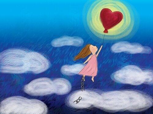 Mädchen an Herzluftballon