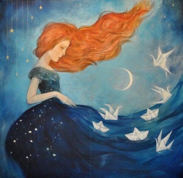 Frau mit Kleid und Ozean