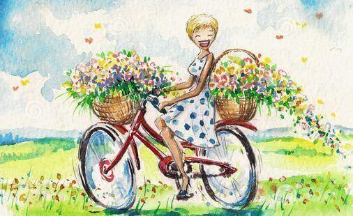Glueckliche Frau auf Fahrrad