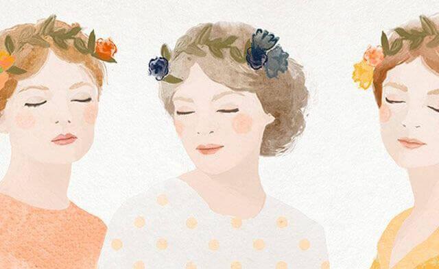 Drei Frauen mit Blumen auf dem Kopf