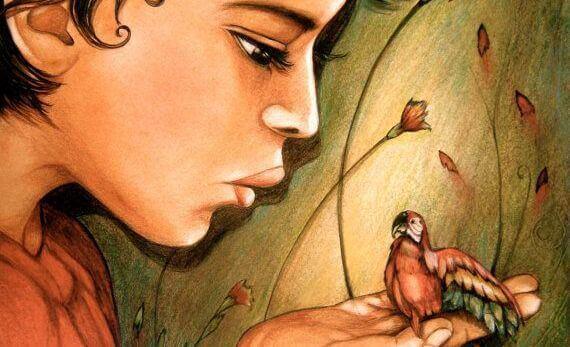 Frau mit kleinem Papagei auf der Hand