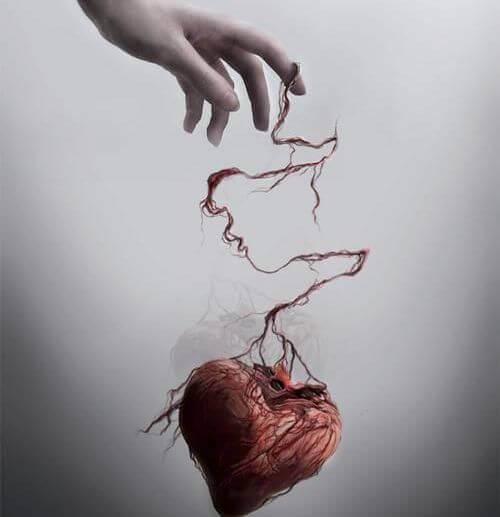 Herz hängt an einer Hand