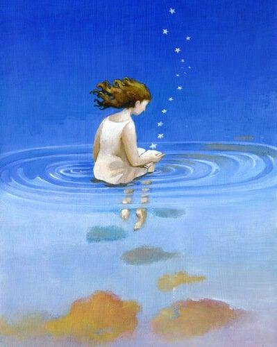 Frau sitzt im Wasser und von ihrer Hand geht eine Sternenkette aus