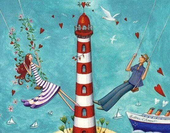 Paar genießt Leben auf der Schaukel neben einem Leuchtturm