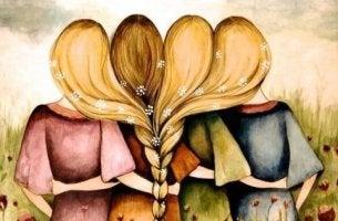 Niemals enttäuschen - vier Freundinnen umarmen sich