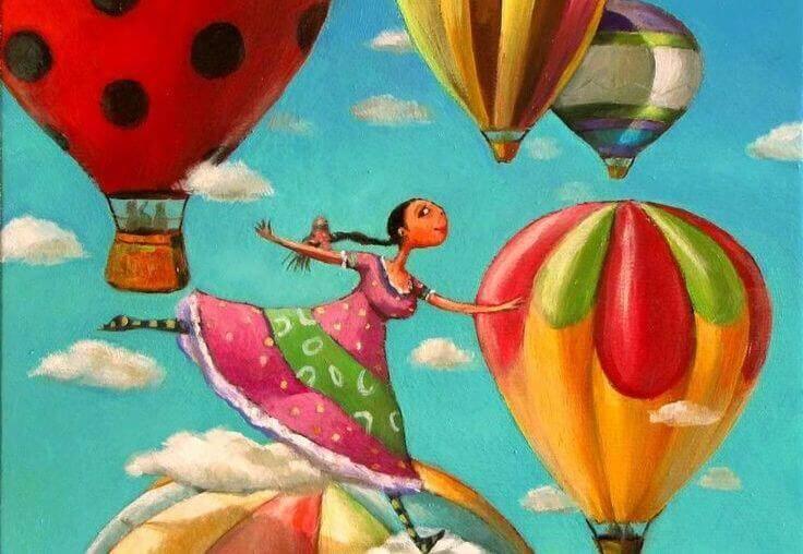 Frau-mit-Ballons-und-positiver-Einstellung hat einen Traum