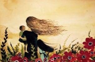 Frau mit Kind auf dem Arm im Blumenfeld
