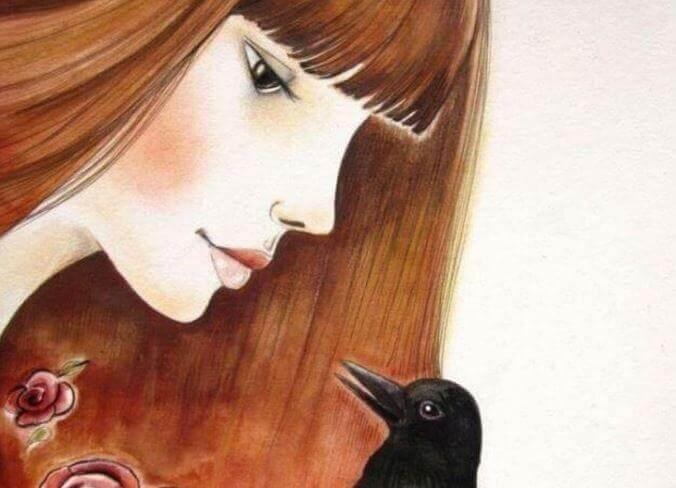 Frau spricht mit Vogel