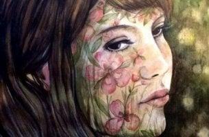 Wie mit Enttäuschungen umgehen? - Frau mit Blumen im Gesicht