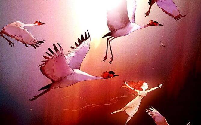 Frau fliegt mit Kranichen