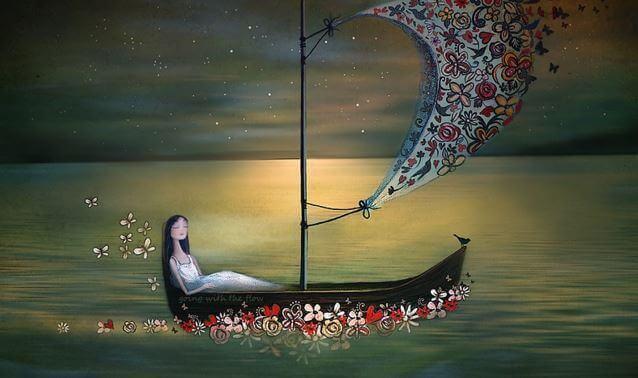 Frau in Boot, das auf Blumen treibt