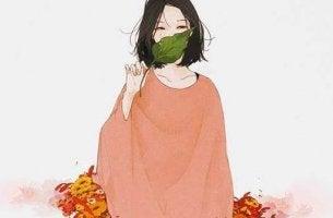 Eine Welt voller Stecknadeln - Frau mit Blatt vorm Mund