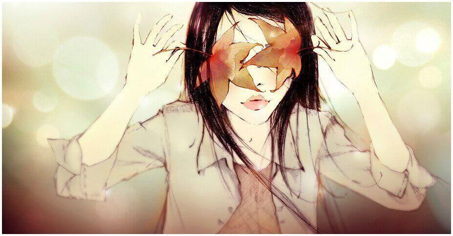 Frau verdeckt sich die Augen