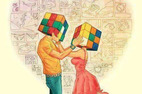 Mann und Frau befühlen den Kopf des jeweils anderen, der ein Rubikwürfel ist