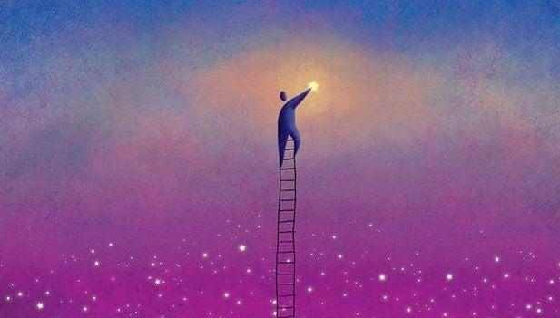 Mann greift nach den Sternen