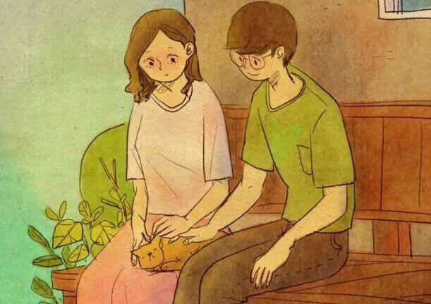 Paar streichelt eine Katze
