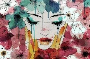 Tränen heilen - weinende Frau inmitten von Blumen