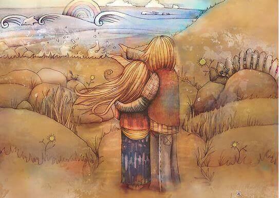 Paar schaut gemeinsam in Richtung Horizont, auf das Meer