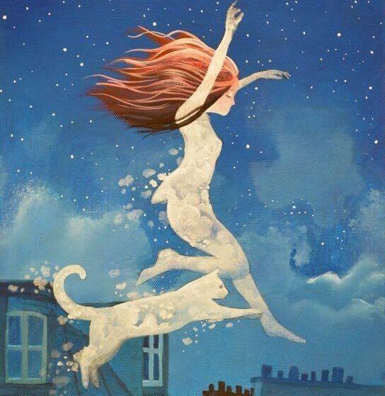 Mädchen und Katze springen