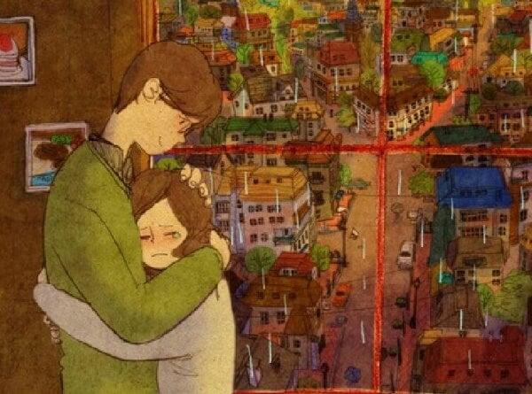 Mann umarmt Frau vor einem Fenster