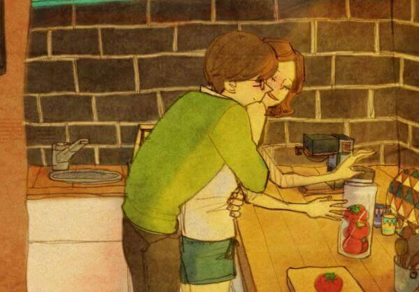 Mann umarmt Frau in der Küche