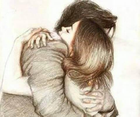 Mann umarmt Frau