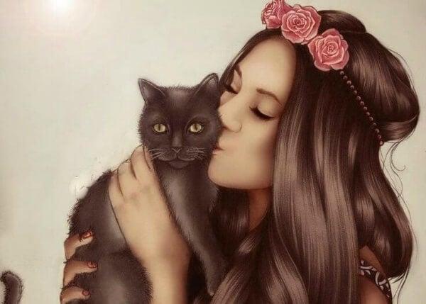Haustiere als Teil der Familie - junge Frau küsst ihre Katze