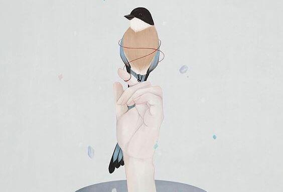 hand-mit-einem-vogel