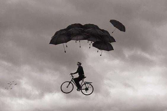 mann-auf-fahrrad-in-der-luft
