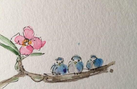 Drei Vögelchen sitzen auf einem Ast