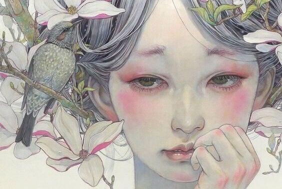 Trauriges Mädchen neben Blüten und einem Vogel