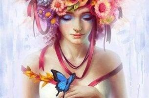 Frau mit Blumen im Haar und Schmetterling auf der Hand
