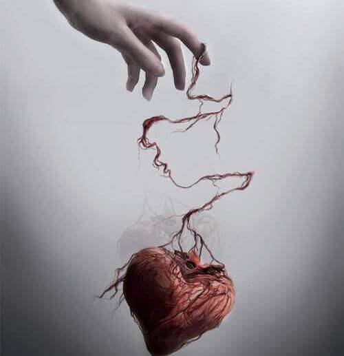 Herz als Marionette am Finger einer anderen Person