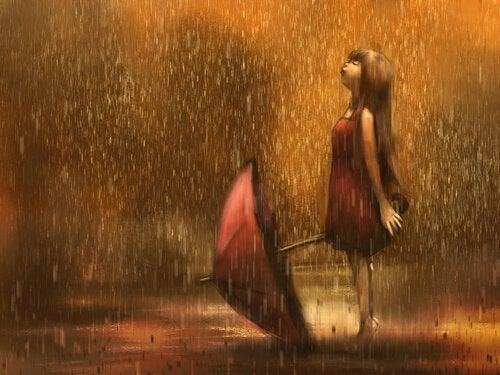 Mädchen mit Schirm im Regen