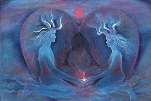 Zwei Seelen, die einander mit den Händen berühren