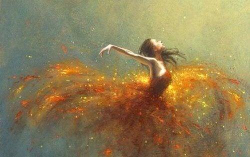 Mit Leidenschaft leben - Tänzerin, deren Kleid Funken sprüht