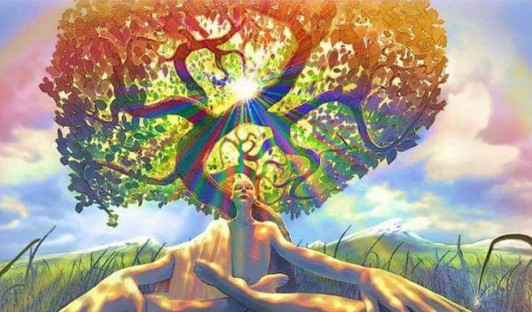 Frau meditiert vor einem Baum, der ein Gehirn zu sein scheint