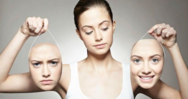 Bipolare Störung - Frau entscheidet sich zwischen zwei Masken
