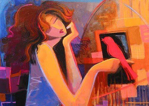 Frau mit rotem Vogel auf der Hand