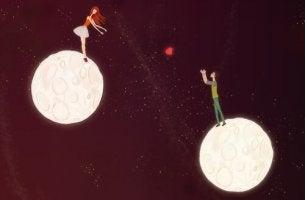Emotionale Distanz kann größer sein als der physische Abstand zueinander - Mann und Frau auf zwei Monden