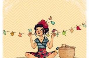 Im neuen Jahr soll alles besser werden - Frau hängt bunte Socken auf