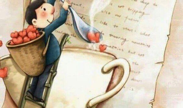 Mann löffelt Herzchen in eine Tasse
