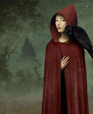 Mädchen im roten Mantel mit einem Raben auf der Schulter