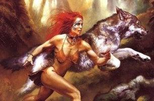 Eine Frau rennt mit Wölfen
