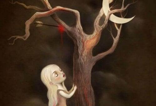 Mädchen, das einen verletzten Baum berührt