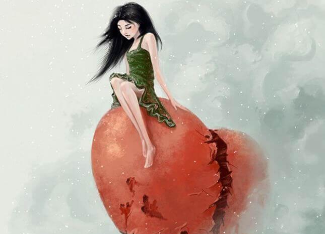 Frau sitzt auf rotem Herz