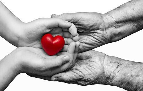Herz wird in die Hände eines anderen gegeben