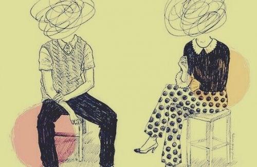 Mann und Frau, die nebeneinander sitzen, und deren Köpfe durch Kringel ersetzt sind