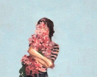 Eine Frau umarmt sich selbst