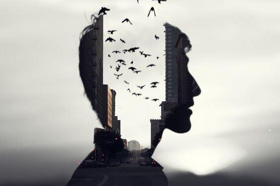Im Schattenbild eines jungen Mannes entsteigen Vögel aus seinem Kopf.